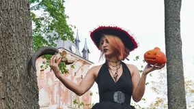 Witch talking with a skull prophecy halloween magic holiday. Horror stock footage