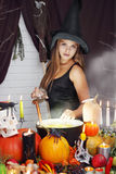 Witch throwing secret ingredient Stock Photos