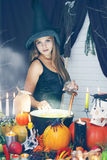 Witch throwing secret ingredient, tinted Stock Photography