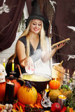 Witch throws an apple. Into the pot Stock Photo