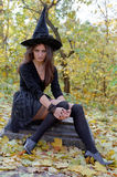 Witch on tomb stone Stock Photo