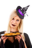 Witch with treats Stock Images