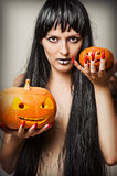 Witch and two pumpkins Stock Photography