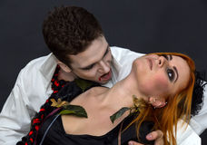 Witch and a vampire. On a dark background royalty free stock photos