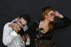 Witch and a vampire. On a dark background Royalty Free Stock Photo