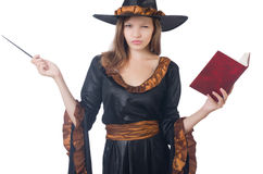 Witch with wand and book Royalty Free Stock Photography