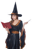 Witch with wand Stock Images