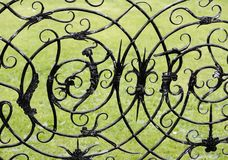 Witch and witchcraft symbols. On a wrought iron gate ashby hall northamptonshire the midlands england uk Royalty Free Stock Photography