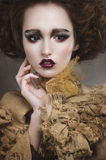 Witch woman with creative makeup. Portrait of an enchanting witch woman, beautiful and glamorous Royalty Free Stock Image