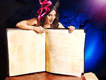 Witch woman holding open book. Royalty Free Stock Photos