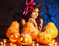 Witch woman with Jack O'Lantern. Stock Photo