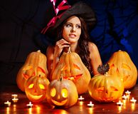 Witch woman with Jack OLantern. Stock Photos
