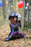 Witch in wood. The girl in a suit of a witch in wood royalty free stock photography