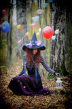 Witch in wood Stock Photography