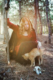 Witch in the wood. Practicing magic. Royalty Free Stock Photography