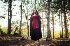 Witch in the wood. Practicing magic. Royalty Free Stock Photos