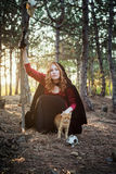 Witch in the wood. Practicing magic. Royalty Free Stock Images