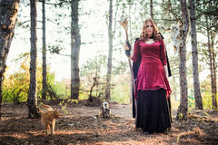 Witch in the wood. Practicing magic. Stock Photo