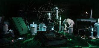 Witchcraft composition with candles, skull and pentagram Royalty Free Stock Image