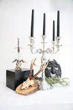 Witchcraft. Items for witchcraft - books, pentacle and candles, skull, sword Stock Image