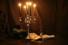 Witchcraft. Items for witchcraft - books, pentacle and candles, skull, sword royalty free stock photography