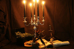 Witchcraft. Items for witchcraft - books, pentacle and candles, skull, sword Stock Photo