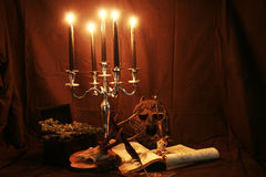 Witchcraft. Items for witchcraft - books, pentacle and candles, skull, sword Royalty Free Stock Images