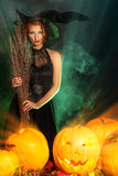 Witchcraft lady. Fairy wicked witch in the wizarding lair. Magic. Halloween Stock Photography