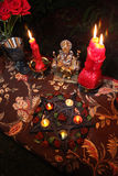 Witchcraft wedding ceremony. Burning candles on table with ornaments and pentagram during traditional witchcraft wedding Royalty Free Stock Images
