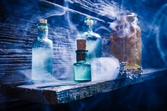 Free Witcher Cottage With Blue Magic Potion For Halloween Royalty Free Stock Images - 99341399