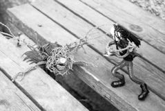 The Witcher fights a monster on an old broken bridge. Vintage film style. Handmade art stock images