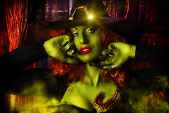Witchery woman. Close-up portrait of a fairy wicked witch in the wizarding lair. Magic. Halloween Stock Photography