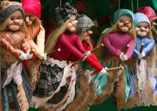 Witches. Handcrafted beautifully dressed witches flying on their besoms Royalty Free Stock Photo