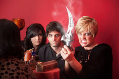 Witches With Athame Blade. Modern witches with sharp Athame over red background Royalty Free Stock Photography