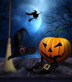Witches broom hat and shoes with  Halloween background Stock Photos