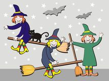 Witches on broomsticks Stock Photography