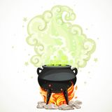 Witches cauldron with green potion and steam to heat the object Royalty Free Stock Images