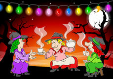 Witches celebrate a halloween party with magic potion Royalty Free Stock Image