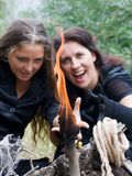 Witches conjure the fire Royalty Free Stock Photo