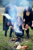 Witches conjure with potion. Three witches conjure with potion, in the forest Royalty Free Stock Photography