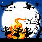 Witches dancing around fire at halloween. Vector illustration of witches dancing around the fire at halloween Stock Photo