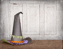 Witches hat with grunge background. And cracked vintage door stock photo