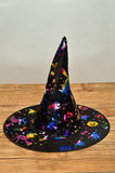 A witches hat. On a wooden background Stock Image
