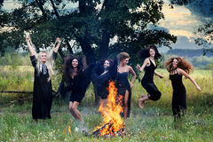 Witches laughing around the campfire Stock Photo