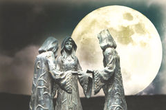 Witches and moonlight. Three witches doing ritual at moonlight royalty free stock images