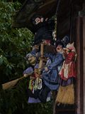 Witches near an old house. Witches hanging on a chain beside a old hous inthe forest Royalty Free Stock Photos