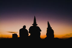 Witches at sunset in Brazil. Three witches admiring the sunset in Brazilian city stock images