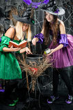 Witches in their hats brew potions Royalty Free Stock Photos