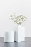Wite gipsophila in a white vase. On a white background Royalty Free Stock Image