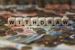 Withdraw - cube with letters, money sector terms - sign with wooden cubes Royalty Free Stock Photography